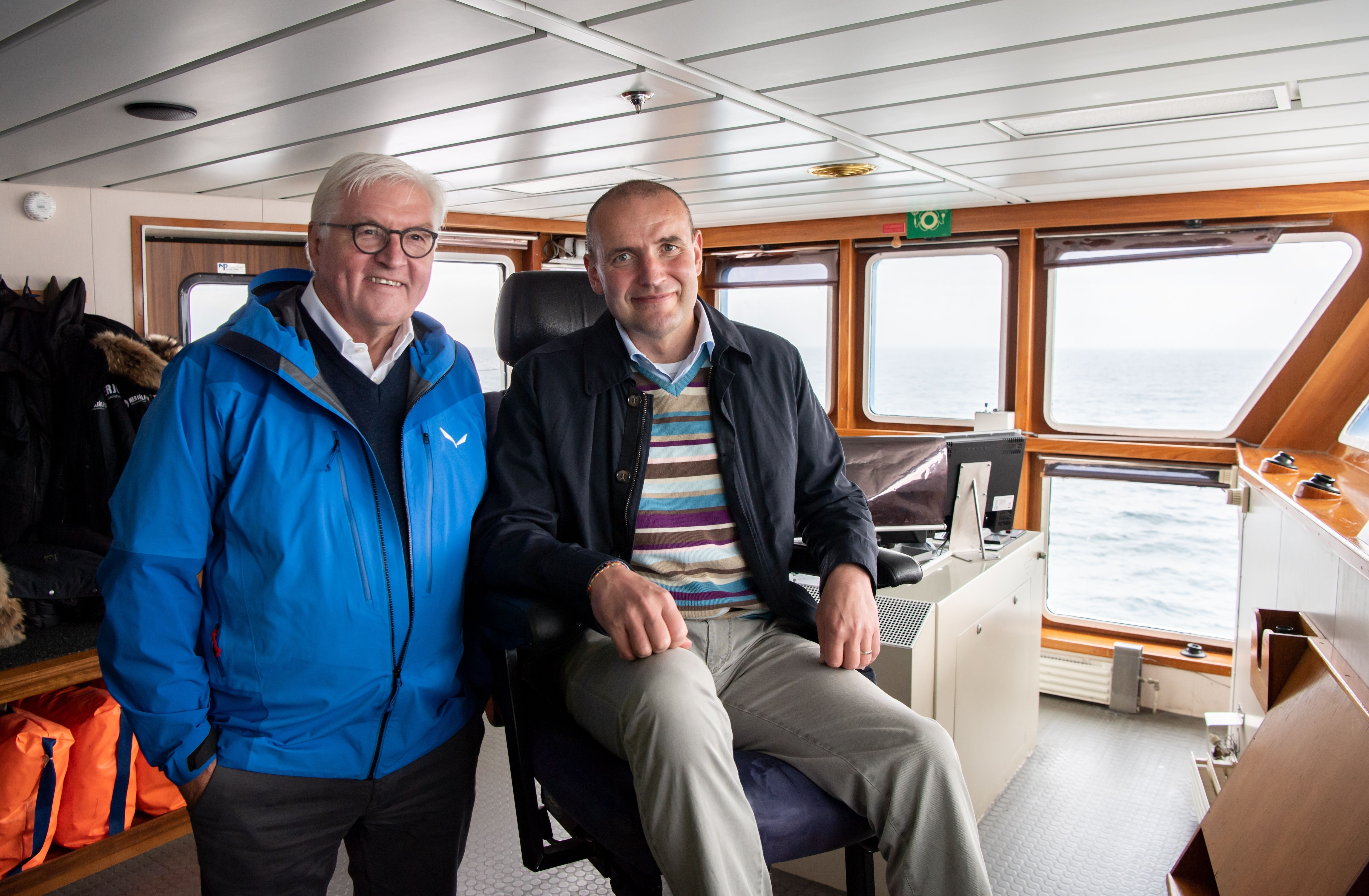 13/06/2019 13 June 2019, Iceland, Reykjavik: German President Frank-Walter Steinmeier (L) and Gudni Thorlacius Johannesson President of Iceland, take a ferry to Heimaey Island on the Westman Islands. Steinmeier and his wife are on a two-day state visit to Iceland. Photo: Bernd von Jutrczenka/dpa POLITICA INTERNACIONAL Bernd von Jutrczenka/dpa