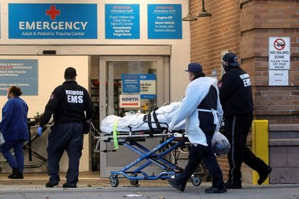 FILE PHOTO: A patient arrives outside Maimonides Medical Center, as the spread of the coronavirus disease (COVID-19) continues, in Brooklyn, New York, U.S., November 17, 2020. REUTERS/Brendan McDermid