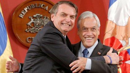 Jair Bolsonaro y Sebastián Piñera (REUTERS/Rodrigo Garrido)
