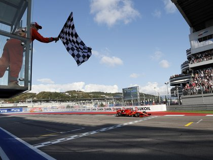 FILE PHOTO: Formula One F1 - Russian Grand Prix - Sochi Autodrom, Sochi, Russia - September 29, 2019 Ferrari's Charles Leclerc crosses the finish line. Yuri Kochetkov/Pool via REUTERS/File Photo