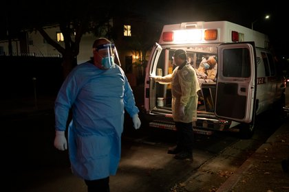 FILE -- A patient is brought my medical transport to a nursing home in Hollywood, Calif., Dec. 9, 2020. An experiment testing whether monoclonal antibodies could prevent coronavirus infections in nursing home staff members and residents has succeeded, the drug maker Eli Lilly claimed on Jan. 21, 2021.  (Gabriella Angotti-Jones/The New York Times)