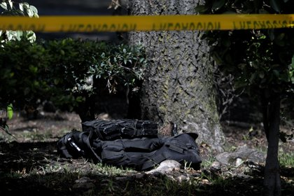 A flak jacket with magazines is seen at a crime scene following an assassination attempt of Mexico City's police chief Omar Garcia Harfuch, at the upscale neighborhood of Lomas de Chapultepec, in Mexico City, Mexico June 26, 2020. REUTERS/Luis Cortes