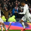 Real Madrid's Brazilian midfielder Casemiro (R) celebrates with Real Madrid's Spanish defender Dani Carvajal after scoring a goal during the Spanish League football match between Real Madrid and Sevilla at the Santiago Bernabeu stadium in Madrid on January 19, 2019. (Photo by PIERRE-PHILIPPE MARCOU / AFP)