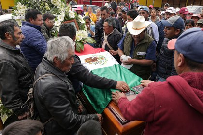 Relatives and friends carry the coffin of environmental activist Homero Gomez, who fought to protect the famed monarch butterfly and was found dead two weeks after he disappeared, during his funeral service in the western Mexican state of Michoacan, Mexico January 30, 2020. REUTERS/Alan Ortega