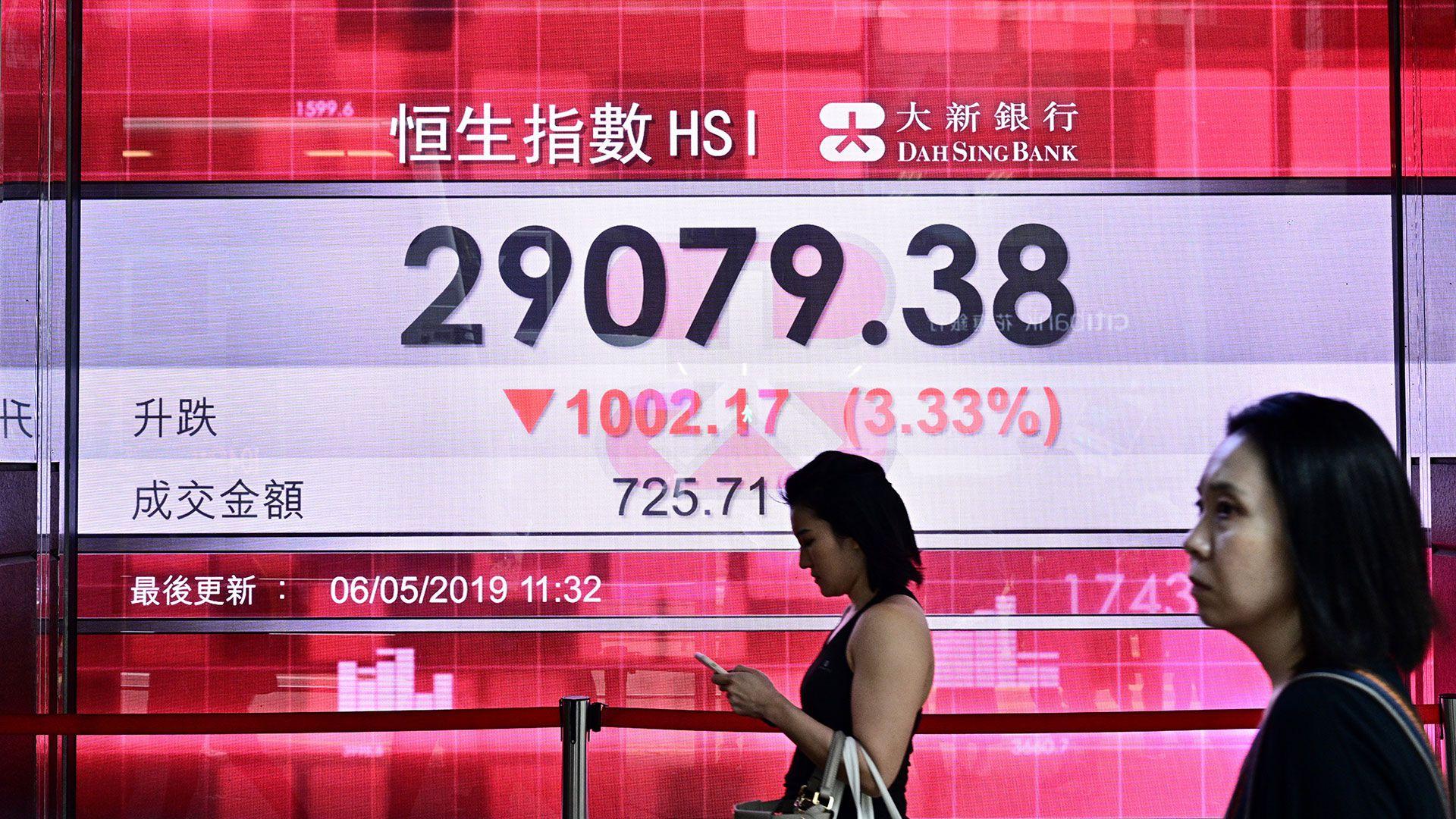 Los mercados asiáticos están siendo presionados por la guerra comercial (AFP)