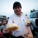 Bolivia's President and current presidential candidate for the Movement for Socialism (MAS) party Evo Morales offers fruit to residents on a street in Shinahota in the Chapare region, Bolivia, October 19, 2019. Reuters Photographer Ueslei Marcelino: