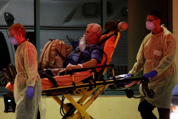 Rescue workers push a stretcher with a patient from the Zaandam of the Holland America Line cruise ship, afflicted with coronavirus disease (COVID-19), at Broward Health Medical Center in Fort Lauderdale, Florida, U.S., April 2, 2020. REUTERS/Marco Bello