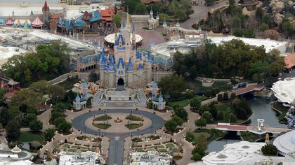 FILE PHOTO: Cinderella Castle is seen at the end of an empty Main Street at Disney's Magic Kingdom theme park in an aerial view in Orlando, Florida, U.S. March 16, 2020.  REUTERS/Gregg Newton/File Photo