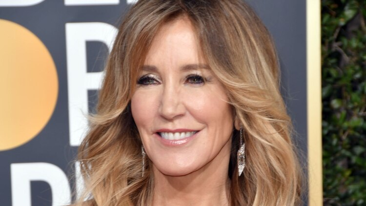Felicity Huffman paid for her daughter to be accepted at the university (Credit: Grosby)