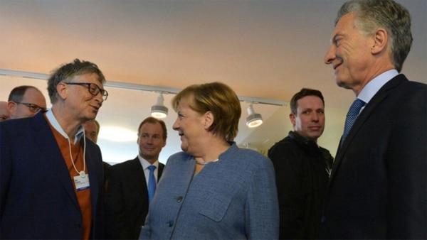 El momento en el que coinciden Bill Gates, Angela Merkel y Mauricio Macri