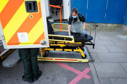 A crew member, from South Central Ambulance Service, operated by South Central Ambulance Service NHS Foundation Trust, wearing protective clothing disinfects the cabin and medical equipment of her ambulance after responding to a 999 call near Portsmouth, U.K. on May 5.