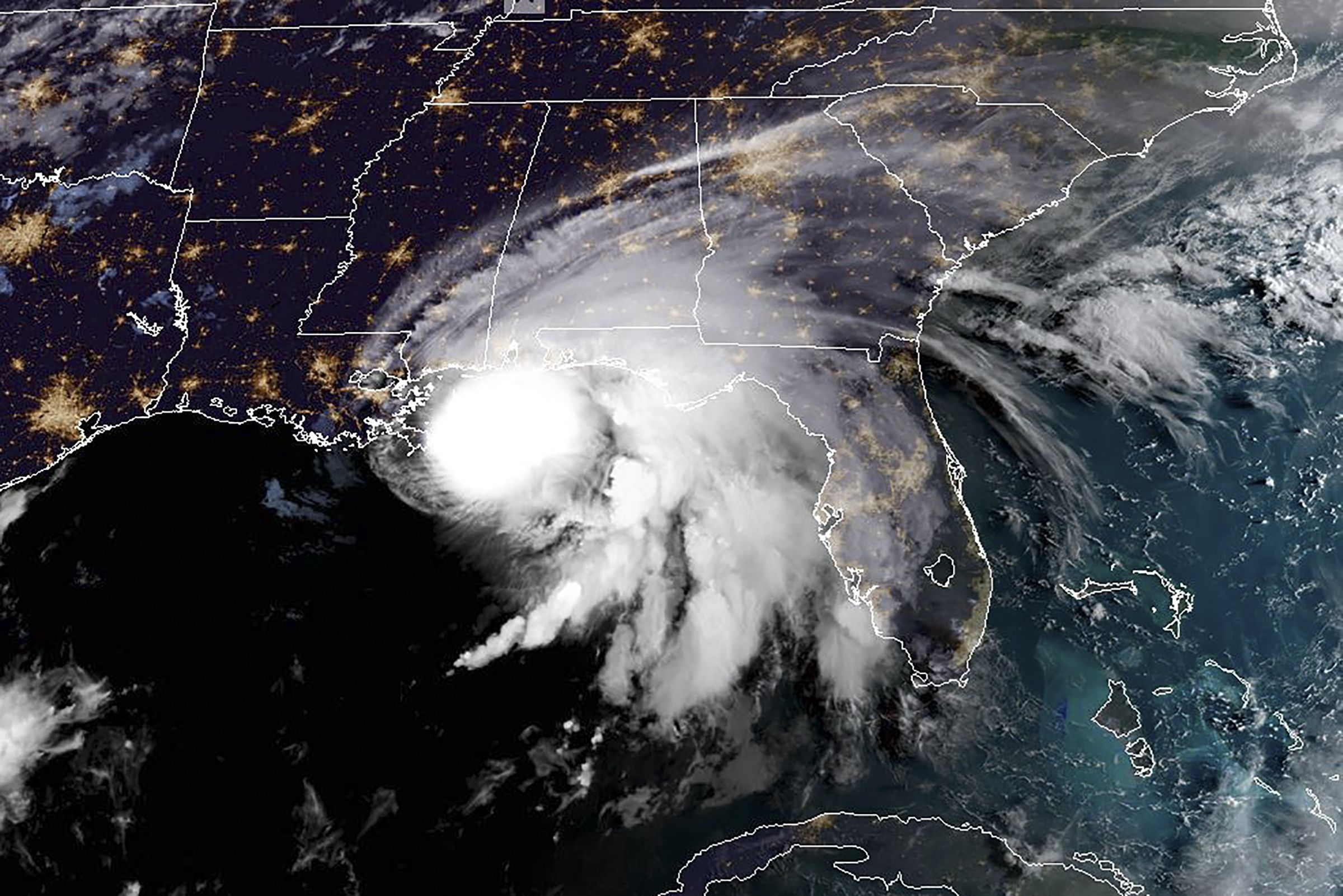 """This RAMMB/NOAA satellite image shows Hurricane Sally off the US Gulf Coast on September 15, 2020, at 12:00 UTC. - Hurricane Sally is set to hit parts of the US Gulf Coast with rain for another day Tuesday before it makes landfall, raising fears that significant flooding is in store for coastal Mississippi, Alabama and the Florida Panhandle. The center of Sally -- a Category 1 storm with maximum sustained winds of 85 mph -- was moving over the Gulf of Mexico and toward coastal Mississippi only at 2 mph early Tuesday. (Photo by Handout / RAMMB/NOAA/NESDIS / AFP) / RESTRICTED TO EDITORIAL USE - MANDATORY CREDIT """"AFP PHOTO / RAMMB/NOAA"""" - NO MARKETING - NO ADVERTISING CAMPAIGNS - DISTRIBUTED AS A SERVICE TO CLIENTS"""