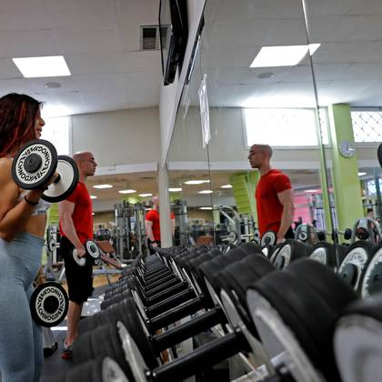 People exercise at a gym which has reopened with new social distancing and hygiene rules after months of closure due to an outbreak of the coronavirus disease (COVID-19), in Rome, Italy, May 25, 2020. REUTERS/Remo Casilli