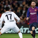 Soccer Football - La Liga Santander - FC Barcelona v Valencia - Camp Nou, Barcelona, Spain - February 2, 2019 Barcelona's Lionel Messi in action with Valencia's Francis Coquelin REUTERS/Albert Gea
