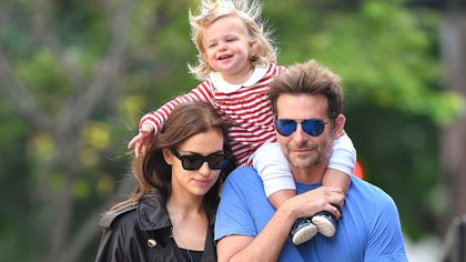 Photo © 2018 Splash News/The Grosby Group  New York, October 05, 2018. Couple Bradley Cooper and Irina Shayk take their daughter Lea De Seine Shayk Cooper out for brunch at Cafe Cluny in New York. Cooper was dressed casual in a blue t-shirt and jeans, while Irina looked stylish in a long black trench coat and flats. The happy family shared some laughs while taking a stroll. Lea is also seen laughing as she pulls her mothers hair while enjoying a ride on her dad's shoulders.