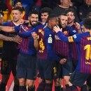 Barcelona's players celebrate after Barcelona's Uruguayan forward Luis Suarez scored during the Spanish league football match Villarreal CF against Barcelona at La Ceramica stadium in Vila-real on April 2, 2019. (Photo by JOSE JORDAN / AFP)