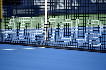 FILE PHOTO: Aug 8, 2019;  Montreal, Quebec, Canada;  Close up of the net and ATP logo during the Rogers Cup tennis tournament at Stade IGA.  Mandatory Credit: Eric Bolte-USA TODAY Sports / File Photo
