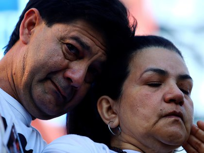 Fernando Baez Sosa's parents, Silvio Baez and Graciela Sosa, a 19-year-old who was beaten to death a month ago in the coastal resort of Villa Gesell in Buenos Aires province, mourn his death during a protest outside of National Congress, in Buenos Aires, Argentina February 18, 2020. REUTERS/Matias Baglietto