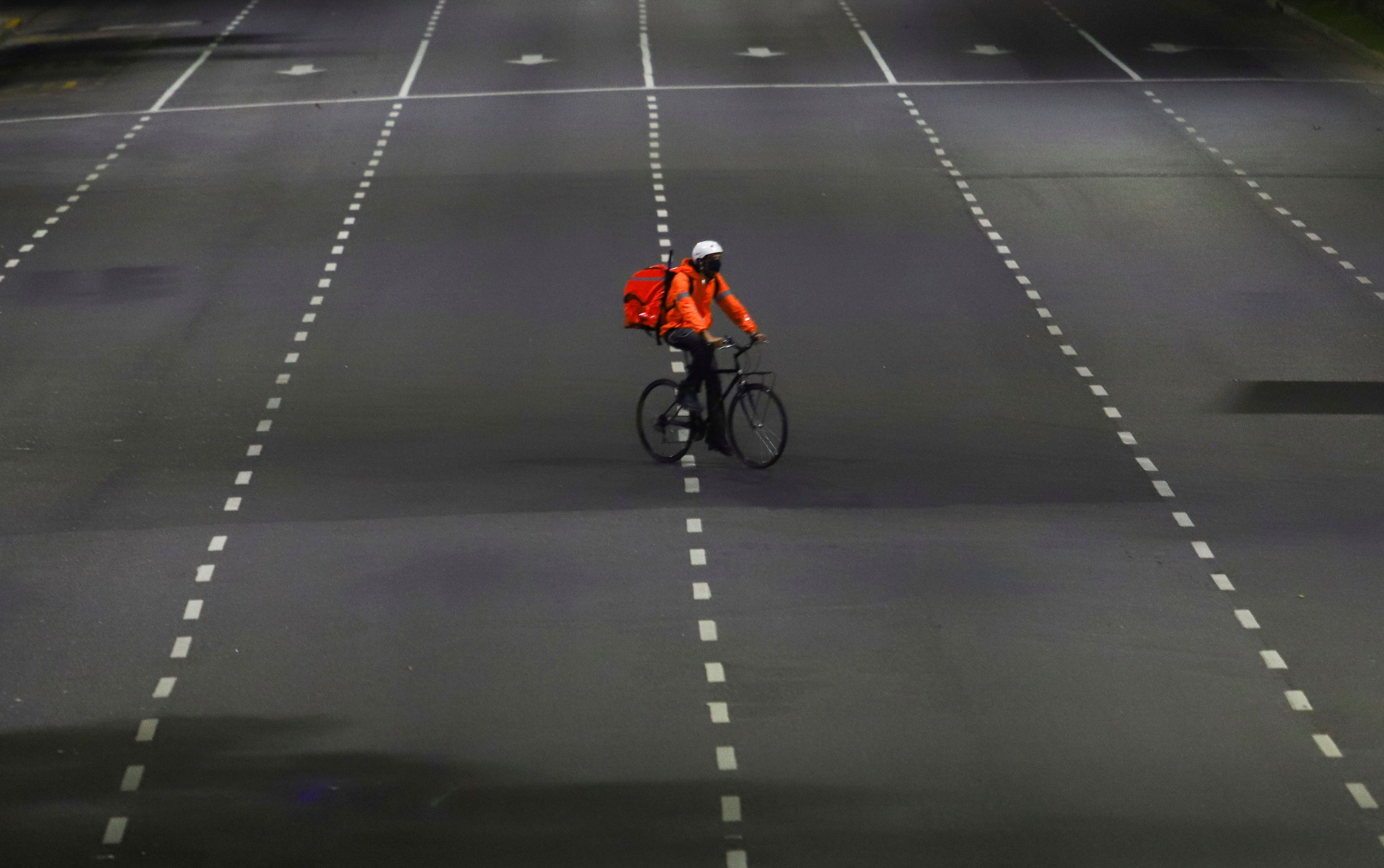 FILE PHOTO: A man who works for the mobile delivery app Rappi rides his bike on the street in Buenos Aires, Argentina April 10, 2020 REUTERS/Matias Baglietto/File Photo