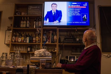France's President Emmanuel Macron speaks during a live televised address on easing lockdown measures in a closed bar in Paris, France, on Tuesday, Nov. 24, 2020. Macron said he will gradually lift a nationwide lockdown this month, as he attempts to avoid a resurgence of the coronavirus and damaging fits and starts for the economy. Photographer: Nathan Laine/Bloomberg