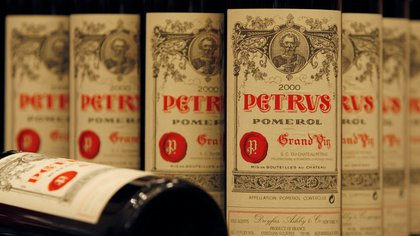 FILE PHOTO: Bottles of 2000 Chateau Petrus are shown at news conference ahead of wine auction in Hong Kong