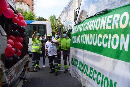 """Les travailleurs qui collectent les déchets ont dit """"Présent"""" le 9 juillet (Maximiliano Luna)"""