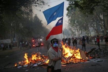 Las protestas en el vecino país también desalentaron a los viajeros argentinos (REUTERS/Edgard Garrido)