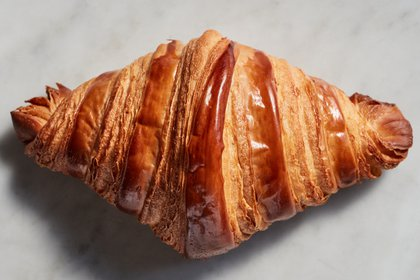 A croissant in New York on March 9, 2021. Get those perfectly burnished, flaky pastries straight from your oven with this expert advice. Food Stylist: Laurie Ellen Pellicano. (Johnny Miller/The New York Times)