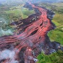 In this Saturday, May 19, 2018, photo released by the U.S. Geological Survey, lava flows from fissures near Pahoa, Hawaii. Kilauea volcano began erupting more than two weeks ago and has burned dozens of homes, forced people to flee and shot up plumes of steam from its summit that led officials to distribute face masks to protect against ash particles. (U.S. Geological Survey via AP)