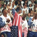 FILE PHOTO: U.S. basketball player Michael Jordan (2nd R) flashes a victory sign as he stands with team mates Larry Bird (L), Scottie Pippen and Clyde Drexler (R), nicknamed the ?Dream Team? after winning the Olympic gold in Barcelona, Spain August 8, 1992. REUTERS/Ray Stubblebine/File Photo