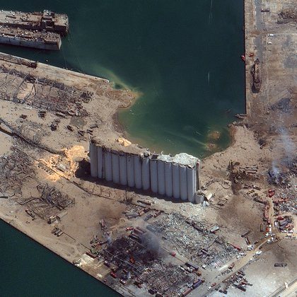 """This August 5, 2020, handout satellite image obtained courtesy of  Maxar Technologies shows an overview of the port after the explosion in Beirut on August 4, 2020. - For at least six years, hundreds of tonnes of ammonium nitrate, which Lebanese authorities say caused Tuesday's massive blast, were negligently stored in a Beirut port warehouse, waiting for disaster to strike. The odourless crystalline substance commonly used as a fertiliser has caused numerous industrial explosions over the decades -- including the massive one in Beirut that killed at least 113 people, wounded thousands and left 300,000 homeless (Photo by Handout / Satellite image �2020 Maxar Technologies / AFP) / RESTRICTED TO EDITORIAL USE - MANDATORY CREDIT """"AFP PHOTO / Satellite image �2020 Maxar Technologies """" - NO MARKETING - NO ADVERTISING CAMPAIGNS - DISTRIBUTED AS A SERVICE TO CLIENTS"""