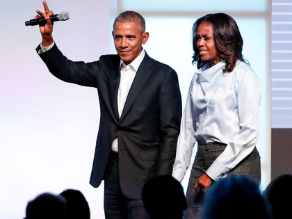 FILE PHOTO: Former U.S. President Barack Obama and former first lady Michelle Obama greet guests during the first day of the Obama Foundation Summit in Chicago, Illinois, U.S. October 31, 2017. REUTERS/Kamil Krzaczynski/File Photo