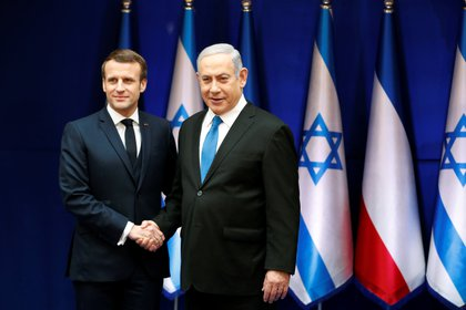 El premier israelí Benjamin Netanyahu y el presidente francés Emmanuel Macron dialogaron en Jerusalén el 22 de enero (REUTERS/Ronen Zvulun/Pool)