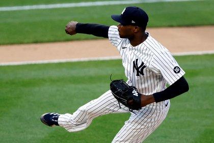 USA BASEBALL MLB:Bronx (United States), 04/05/2021.- New York Yankees starting pitcher Domingo German releases a pitch to the Houston Astros in the first inning of their MLB game in the Bronx, New York, USA, 04 May 2021. (Estados Unidos, Nueva York) EFE/EPA/JASON SZENES