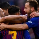 Barcelona's Brazilian midfielder Philippe Coutinho (C) celebrates a goal with teammates during the Spanish league football match between FC Barcelona and Real Madrid CF at the Camp Nou stadium in Barcelona on October 28, 2018. (Photo by GABRIEL BOUYS / AFP)