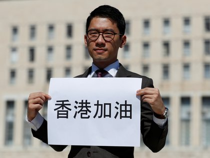 Exiled Hong Kong pro-democracy activist Nathan Law holds a placard outside the Italian Foreign Ministry, ahead of a meeting between Italian Foreign Minister Luigi di Maio and his Chinese counterpart,Wang Yi, in Rome, Italy August 25, 2020. REUTERS/Yara Nard
