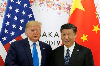 Donald Trump y Xi. REUTERS/Kevin Lamarque/File Photo