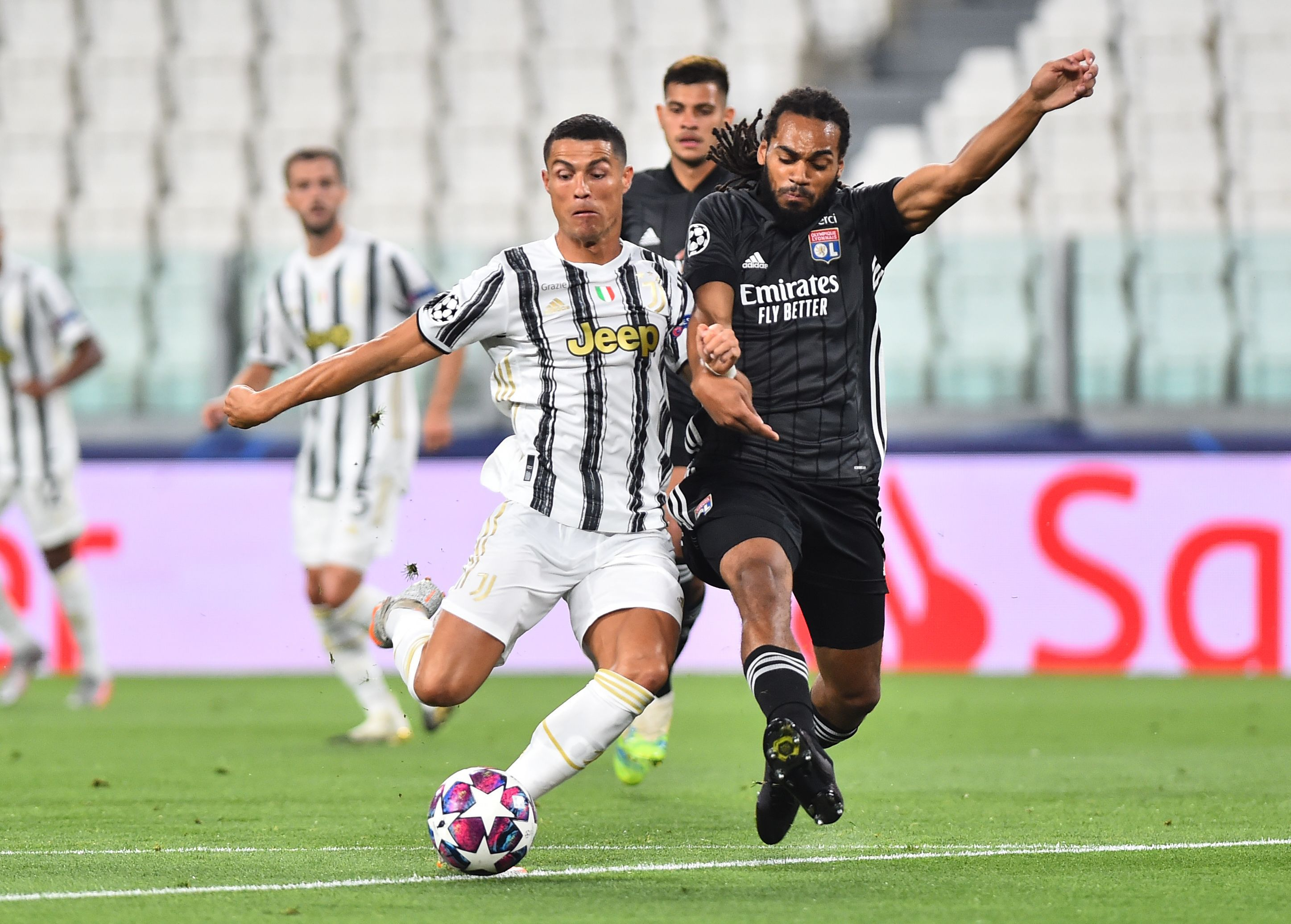 Soccer Football - Champions League - Round of 16 Second Leg - Juventus v Olympique Lyonnais - Allianz Stadium, Turin, Italy - August 7, 2020   Juventus' Cristiano Ronaldo in action with Olympique Lyonnais' Jason Denayer, as play resumes behind closed doors following the outbreak of the coronavirus disease (COVID-19) REUTERS/Massimo Pinca