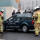 Firefighters remove the car which crashed into the gate of the main entrance of the chancellery in Berlin, the office of German Chancellor Angela Merkel in Berlin, Germany, November 25, 2020. Letters written on the car read: