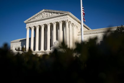 The U.S. Supreme Court in Washington, D.C., U.S., on Monday, Dec. 7, 2020. Bipartisan negotiators on a $908 billion pandemic relief package are planning to unveil more details of their proposal on Monday, aiming to settle on language that can satisfy enough Republicans and Democrats to secure passage of one final tranche of Covid-19 aid before Congress breaks for the year.