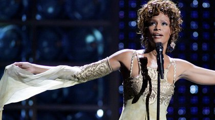 FILE PHOTO: Whitney Houston performs during the World Music Awards at the Thomas & Mack Center in Las Vegas, Nevada, as a tribute to music mogul Clive Davis, who received the Outstanding Contribution to the Music Industry Award, in this September 15, 2004, photo.  REUTERS/Ethan Miller//File Photo