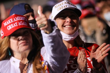 Supporters react as U.S. President Donald Trump holds a campaign rally at John Murtha Johnstown Cambria County Airport in Johnstown Pennsylvania