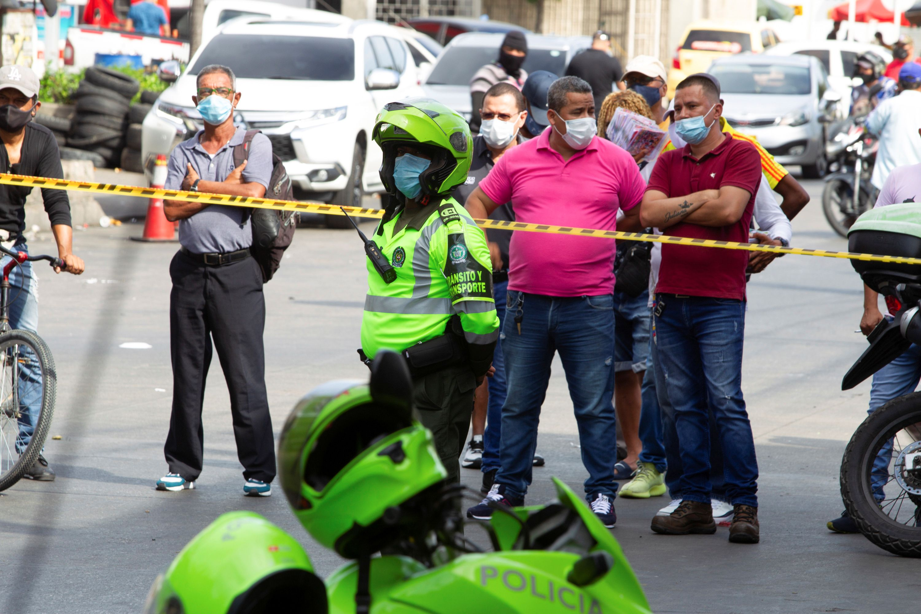 A police officer wearing a face mask patrols the area where criminals set off an explosion which occurred in the center of the city, according to authorities, in Barranquilla, Colombia January 12, 2021. REUTERS/Stringer NO RESALES. NO ARCHIVES