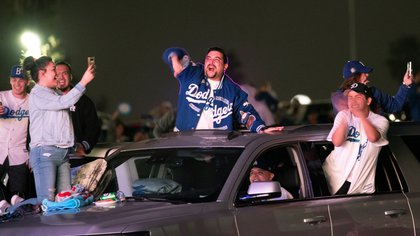 People celebrate during a drive-in viewing of Los Angeles Dodgers against Tampa Bay Rays during game 6 of the 2020 World Series in the parking lot of Dodgers Stadium, amidst the outbreak of the coronavirus disease (COVID-19), in Los Angeles, California , US, October 27, 2020. Picture taken October 27, 2020. REUTERS / Mario Anzuoni