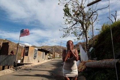 Para los puertorriqueños, la urgencia de tener derechos plenos se acumuló desde que en 2015 el territorio no incorporado cayera parcialmente en default y luego fuera devastado por el Huracán María. (REUTERS/Alvin Baez)