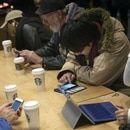 Customers at a Starbucks coffee shop in New York on Jan. 18, 2016. (Bloomberg photo by Victor J. Blue)