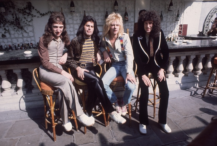8th September 1976: British rock group Queen at Les Ambassadeurs, where they were presented with silver, gold and platinum discs for sales in excess of one million of their hit single 'Bohemian Rhapsody'. The band are, from left to right, John Deacon, Freddie Mercury (Frederick Bulsara, 1946 - 1991), Roger Taylor and Brian May. (Photo by Keystone/Getty Images)