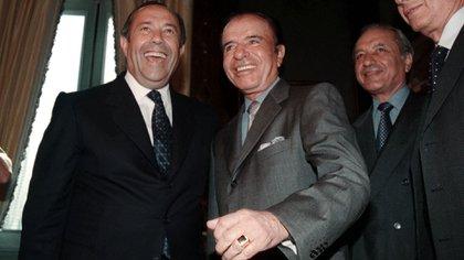 Carlos Saúl Menem junto al ex presidente y gobernador de San Luis, Adolfo Rodríguez Saá. (Foto NA)