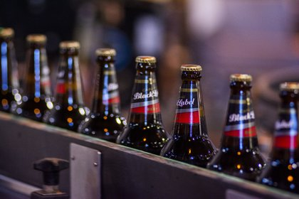 Capped and labelled bottles of Carling Black Label beer Photographer: Waldo Swiegers/Bloomberg