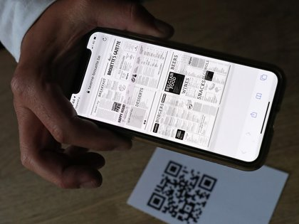 A menu and QR code are pictured at Brasserie La Brouette restaurant as bars and restaurants reopen after weeks of lockdown restrictions amid the coronavirus disease (COVID-19) outbreak, in Brussels, Belgium, June 8, 2020. REUTERS/Yves Herman